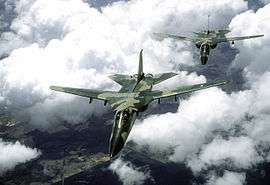 General dynamics f 111c dynamics f 111 aardvark front view of two jet aircraft in two tone green camouflage scheme in flight fandeluxe Image collections