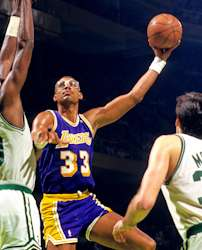 Abdul Jabbar Displaying His Trademark Sky Hook Against The Boston Celtics In Late 1980s Shortly Before Retirement