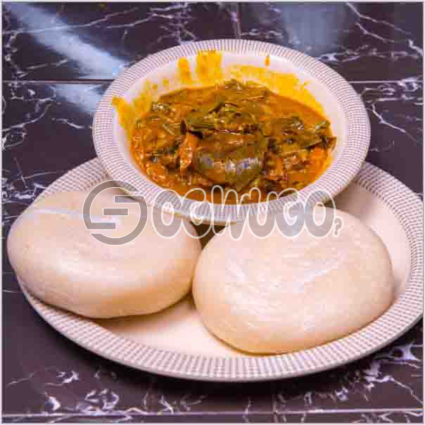 Bitterleaf soup/ Egusi soup or Oha soup with two meats and two balls of balls of swallow,served  with a bottled water. : unable to load image